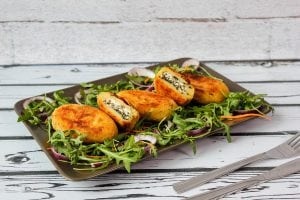 Potato croquettes stuffed with spinach and cheese filling