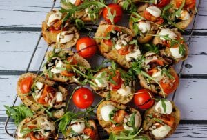 Bruschetta with arugula, tomatoes and mozzarella