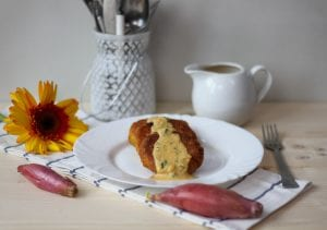 gluten free millet and pumpkin cakes with cheese and pumpkin sauce
