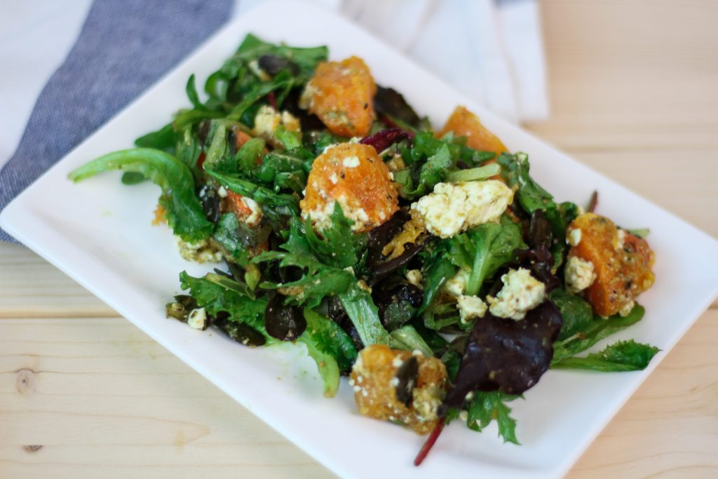 Pumpkin and goat cheese salad with pumpkin seeds