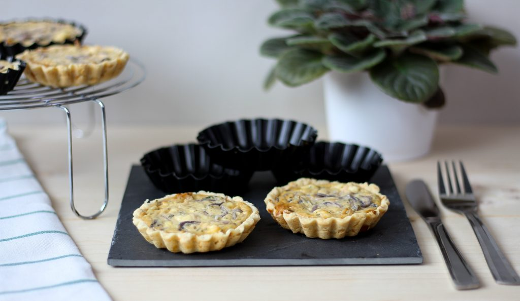 Tarts with cheese and onion