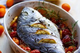 Fish baked with tomatoes and rosemary