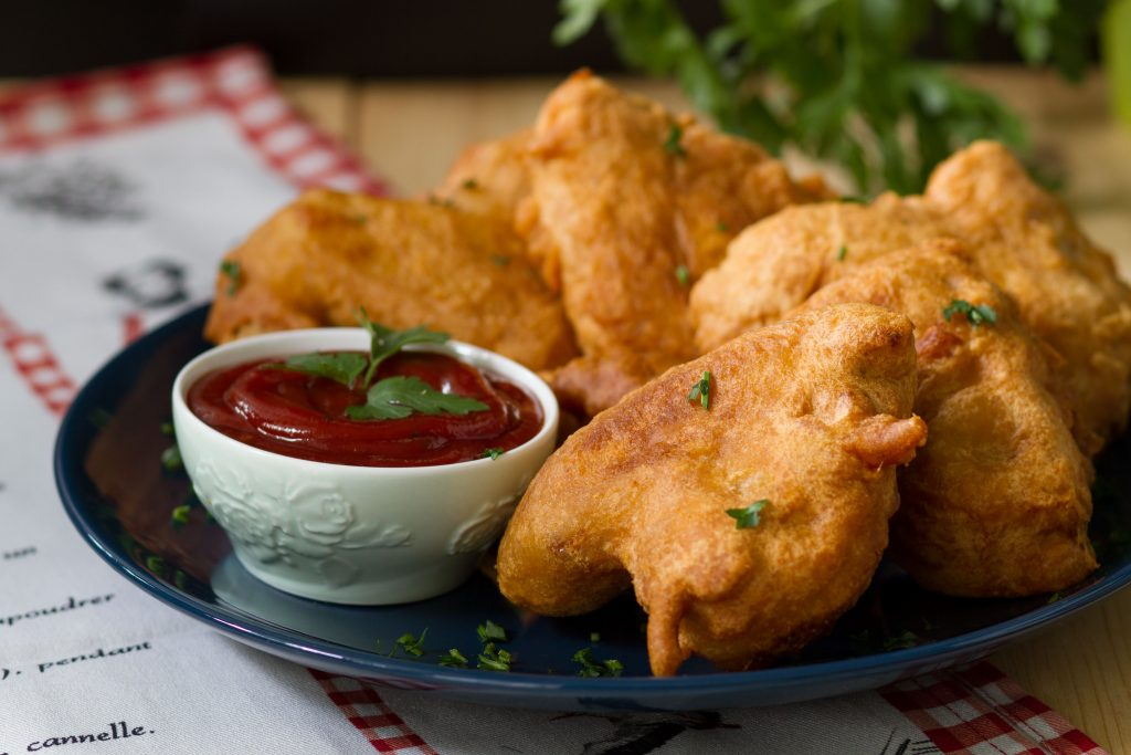 Coated and fried chicken wings