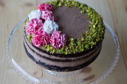 Gluten-free chocolate cake with cream and pistachios