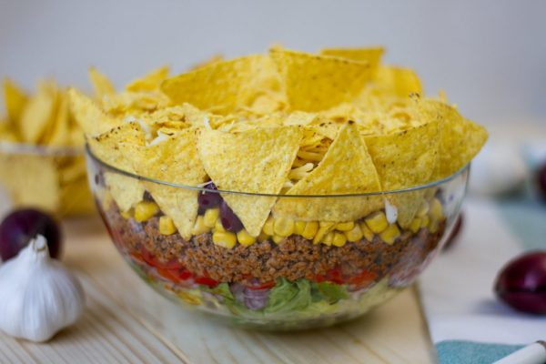 Salad with nachos and minced meat