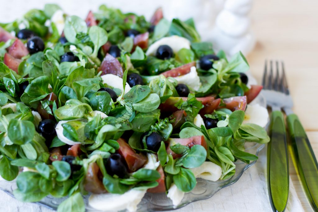 Salad with mozzarella, olives and tomatoes