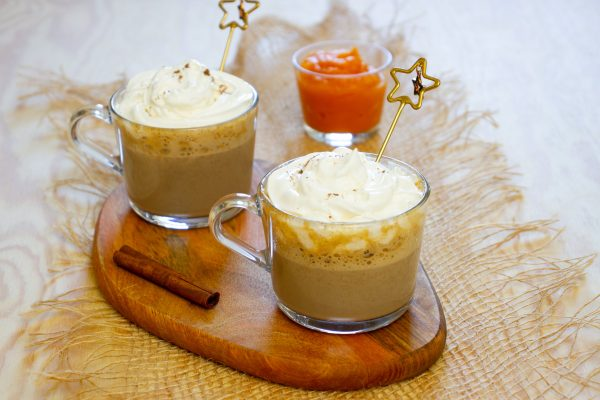 Pumpkin spice latte with cinnamon and whipped cream